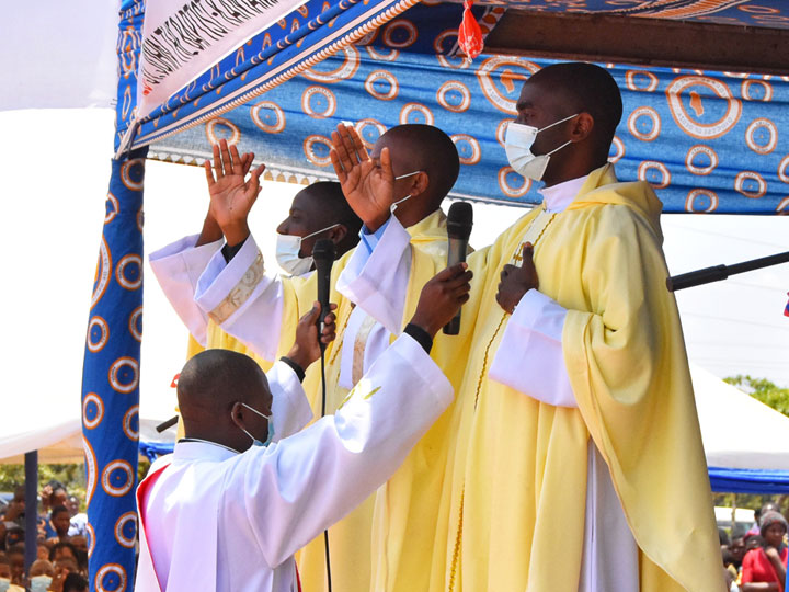 newly ordained priests bless the congregation at Kanyama Parish in Diocese of Dedza